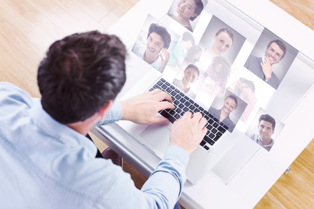 Creative team going over contact sheets in meeting against profile pictures