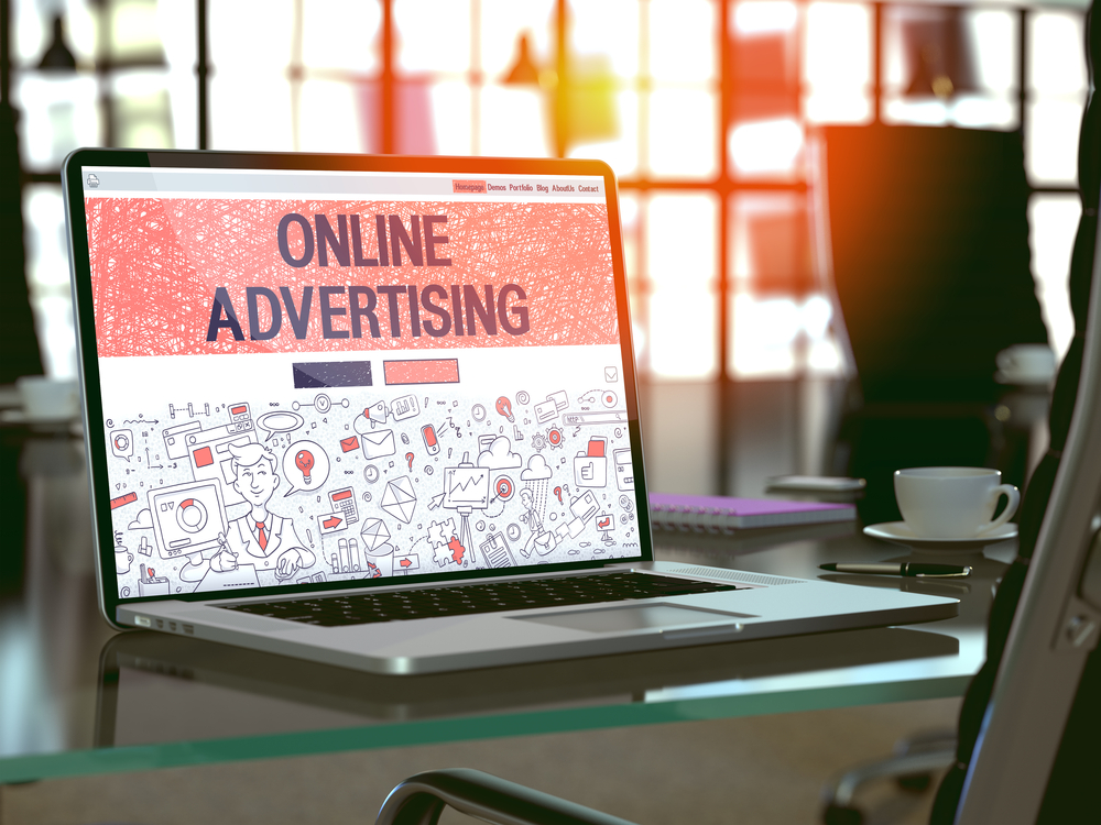 Online Advertising Concept. Closeup Landing Page on Laptop Screen in Doodle Design Style. On Background of Comfortable Working Place in Modern Office. Blurred, Toned Image. 3D Render.-7